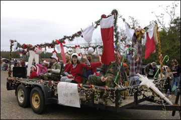 Most Of The Floats Were Like This One A Flat Bed Trailer Decorated For Season With Hay Bales Seats And Filled People Throwing Things To